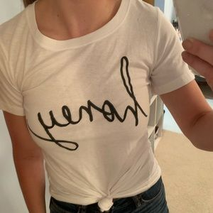 "White tee that says ""honey"" in cursive"